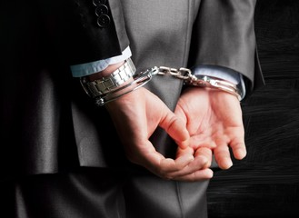 Handcuffs. Corporate crime