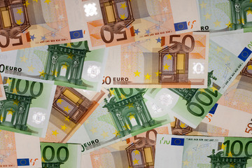 European currency - Fifty Euro Banknotes and One Hundred Euro Ba