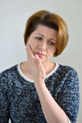 Young woman in pain is having a toothache