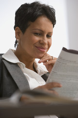 African businesswoman reading paperwork
