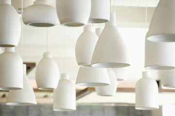 Close up of hanging white pendant lamps