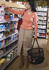 Asian woman shopping for medication