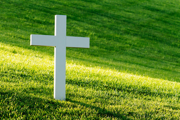 White cross on the grave yard.