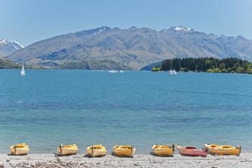 Kayaks docked along beach, Lake Wanaka, Otago, New Zealand