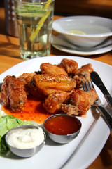 Bbq chicken wings with dips and salad