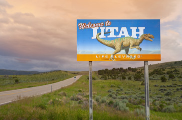 Dinosaur on Welcome to Utah sign along road, Utah, United States