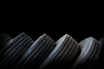 alignment of tires in black background, used tires