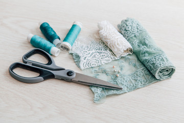 lace, sewing spools and scissors