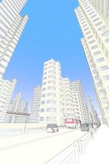 高層ビル街と車道