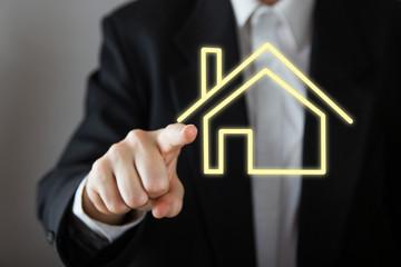 Businessman choosing house, real estate concept. Hand pressing