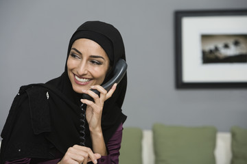 Middle Eastern businesswoman talking on telephone