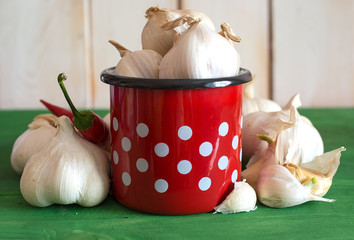 Garlic in red dotted cup