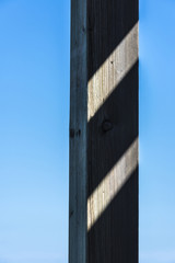 wooden column against the sky