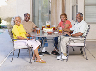 Senior African couples sitting on patio