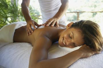 Hispanic woman receiving massage