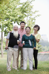 Chinese family smiling in park