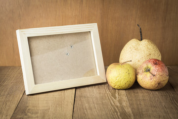 wood frame with space and sear fruit