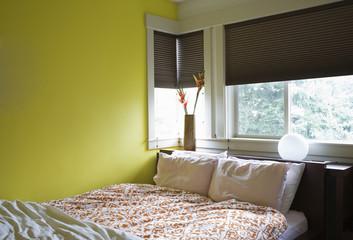 Bed under window in bedroom