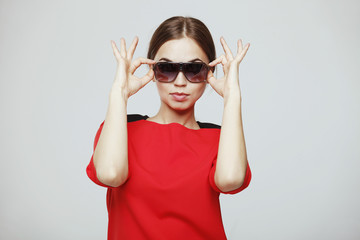 Girl in a red dress and sunglasses