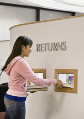 Asian woman returning library books