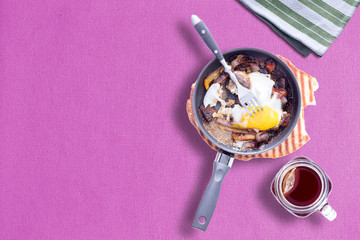 Sunny Side up Omelet on Violet Color Table Cloth with Hot Tea