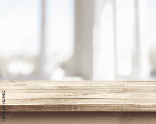 Background. Wooden table on defocuced window with curtain