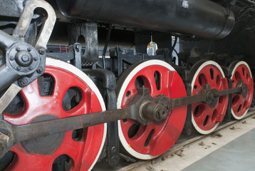 Close up of the rows of steel wheels of a locomotive train