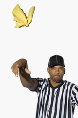 African male referee throwing flag
