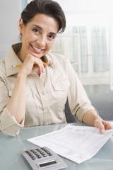 Hispanic woman paying taxes