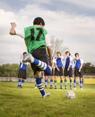 Multi-ethnic male soccer team practicing