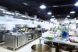 Leinwandbild Motiv modern kitchen and busy chefs
