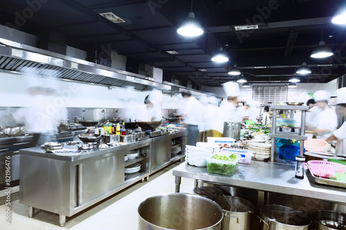 modern kitchen and busy chefs - 82196476