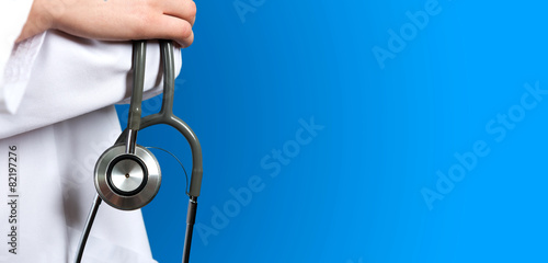 Medical blue background doctor with a stethoscope Photo by koszivu