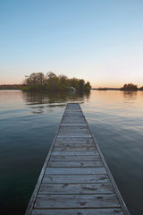 Wooden dock leading to lake