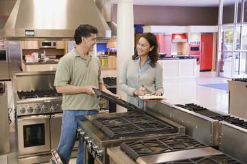 Saleswoman helping customer in appliance showroom