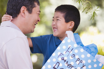 Japanese boy giving father father's day present