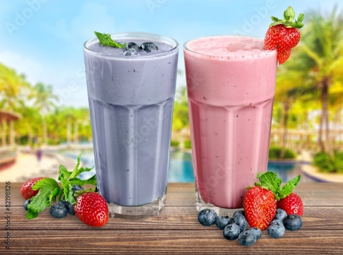 Fruit. Fresh Blueberry and Strawberry Smoothie on a background - 82198826