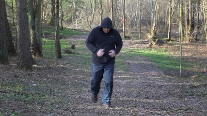 Man running along the trail in the park
