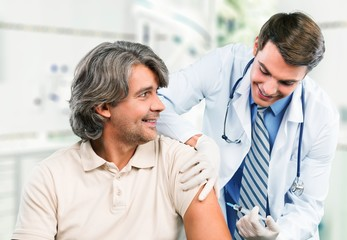 Injecting. Senior Medical - Flu Shot