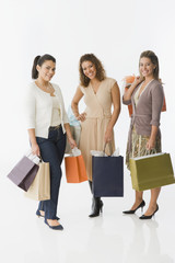 Friends standing with shopping bags