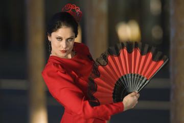 Hispanic woman flamenco dancing