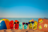 Flip-flops, beach ball and suitcase