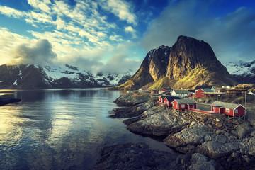 Fishing hut at spring sunset - Reine, Lofoten islands, Norway