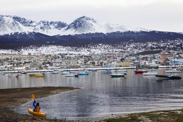 Hispanic kayaker near Ushuaia harbor, Tierra del Fuego, Argentina