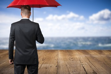Man. Businessman with umbrella in thunderstorm