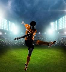 Player. One caucasian man flying kicking playing soccer football