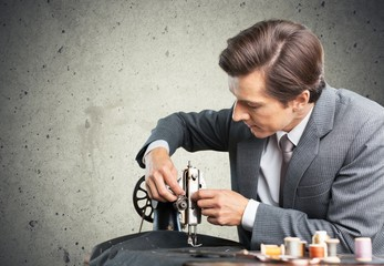 Tailor. Tailors at work. Two confident tailors working on