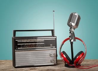 Radio. Retro radio, red microphone, headphones on table old