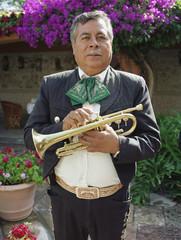 Hispanic man holding trumpet