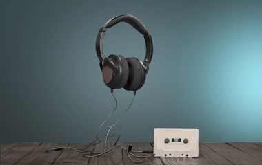 Music. Retro compact cassette with rolls and headphones